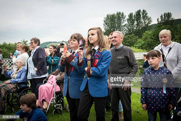 Young Band members film the events with their phones during thee Selkirk Common Riding event on June 13th 2014 The event a celebration of ancient...