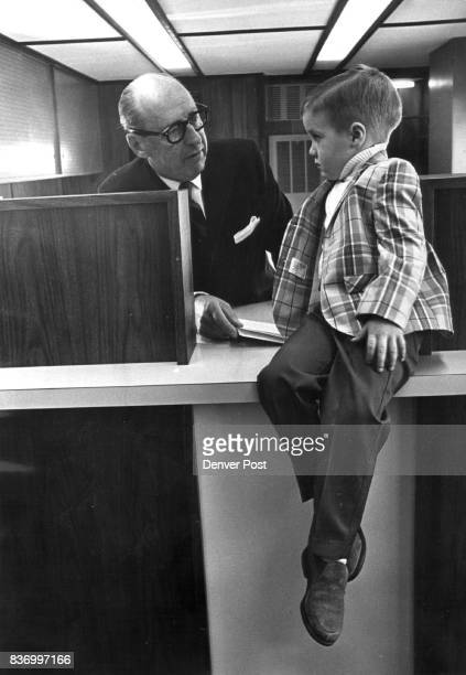 Young Bank Young Customer HJ Bleakley president of MidStates Bank which opened for business Thursday at 3900 E Florida Ave consults with one of the...