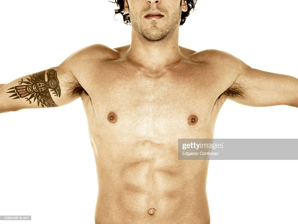 Young bare-chested man, mid section, white background : Stock Photo