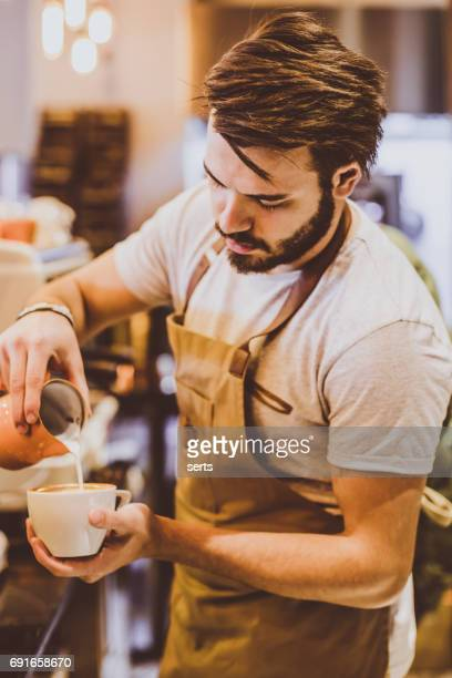 Young Barista Pouring Latte Art