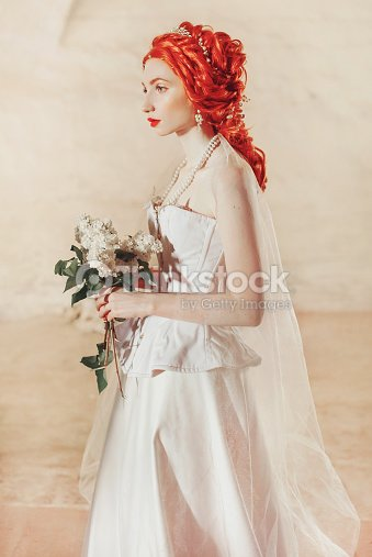c4a5436cebe Young baroque redhead princess with hairstyle in the old castle. Fabulous  rococo queen in white