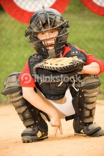 Young Baseball Catcher Signaling To Pitcher Foto de stock | Thinkstock