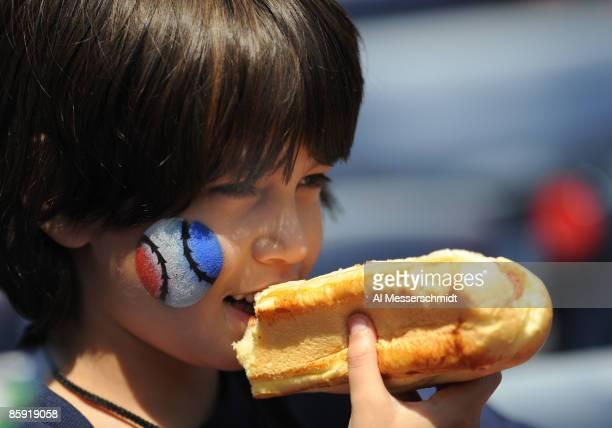 A young baseball fan enjoys a hot dog as the Atlanta Braves host the Washington Nationals April 12 2009 at Turner Field in Atlanta Georgia