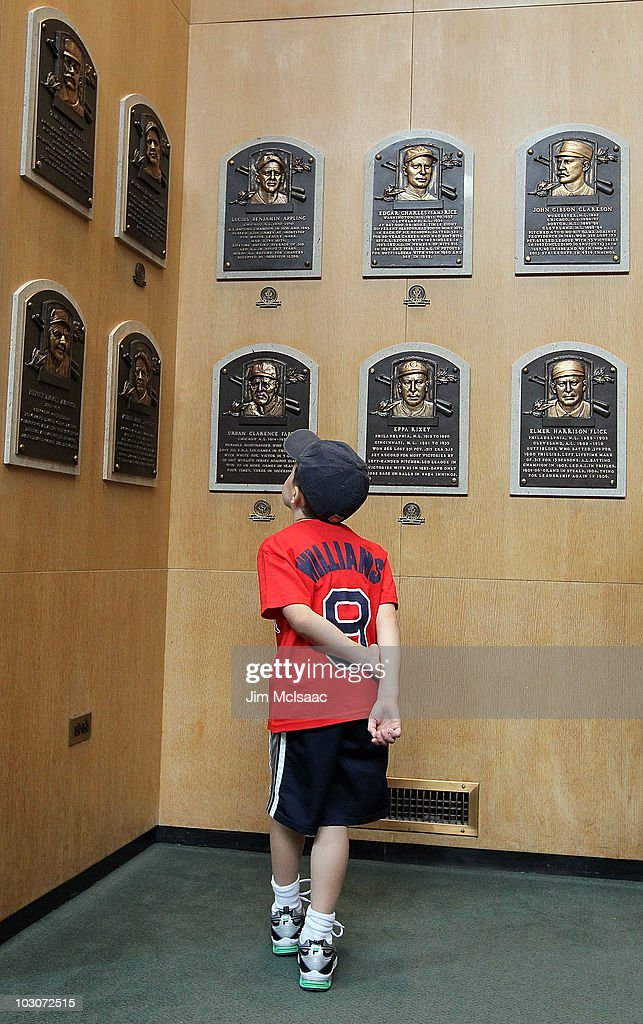 A young baseball fan views the plaques of inducted members at the Baseball Hall of Fame and Museum during induction weekend on July 24 2010 in...