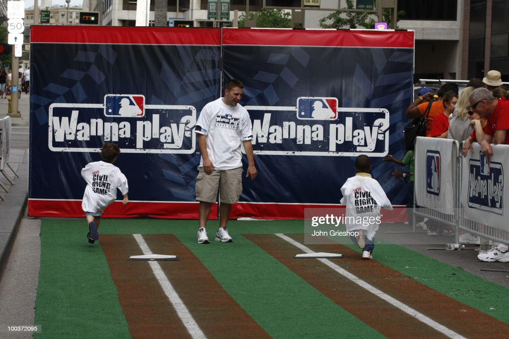 Young baseball fans participate in the Civil Rights Game Youth Summit/Wanna Play Spectacular on Saturday, May 15, 2010, at Fountain Square in Cincinnati, Ohio.