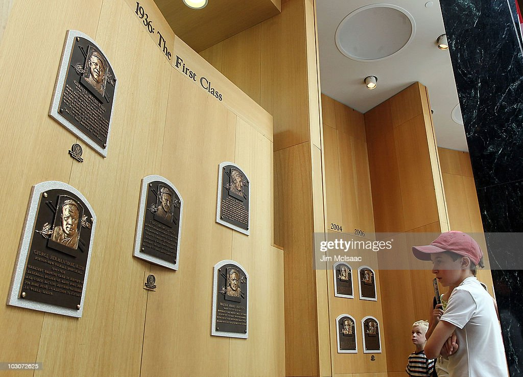 Young baseball fans views the plaques of inducted members at the Baseball Hall of Fame and Museum during induction weekend on July 24 2010 in...