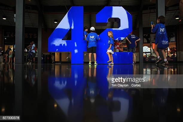 Young baseball fans visit the iconic Jackie Robinson number fortytwo in the Jackie Robinson Rotunda at Citi Field Stadium before the New York Mets V...