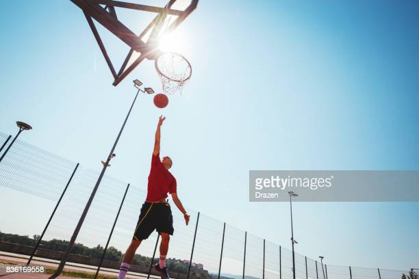 Young basketball player shows slam dunk