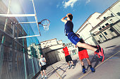 young basketball players playing with energy in a urban place
