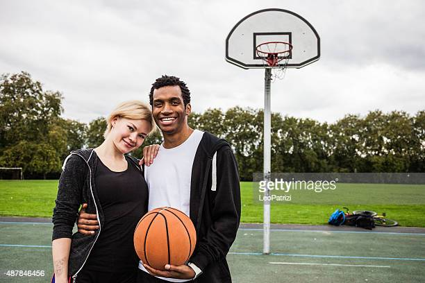 Young basketball players posing at the playground in London