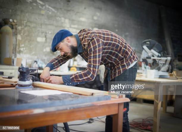 young bearded carpenter at work