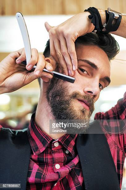 Young Bearded Hipster with Razor