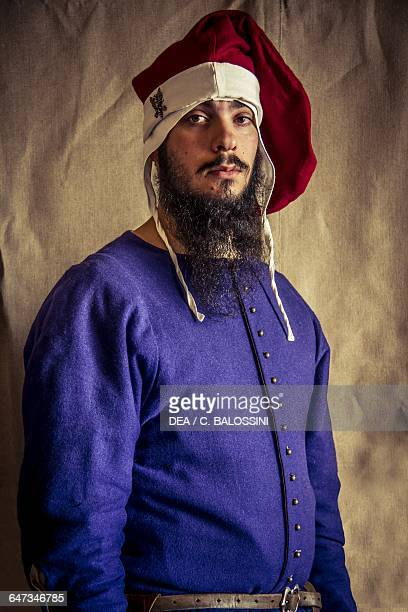 Young bearded man with a hat apothecary of Diotaiuti Imola Italy mid14th century Historical reenactment