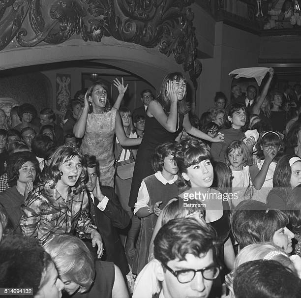 Young Beatle fans scream in disappointment when the spotlight goes off during a benefit to raise money for United Cerebal Palsy and the Retarded...