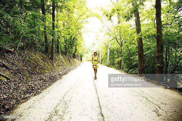 young beautiful adult female on rural road