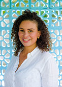 young beautiful and happy latin afro mixed woman on her 30s smiling cheerful and posing fresh outdoors isolated on beautiful background in happiness and success concept