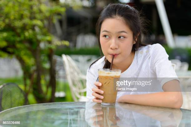 Young beautiful Asian woman relaxing and getting away from it all outdoors