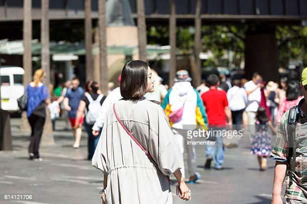 Young beautiful asian woman walking on the street, Sydney Australia