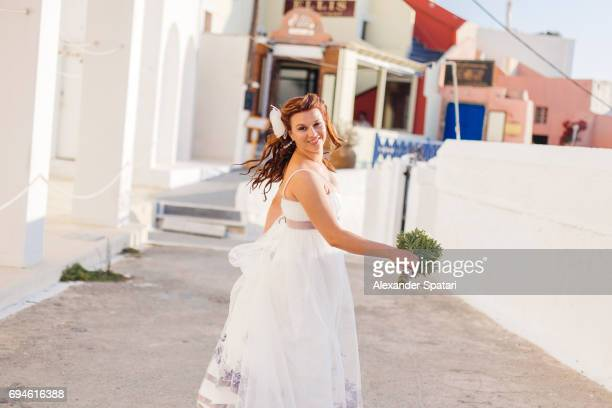Young beautiful bride in Santorini, Greece
