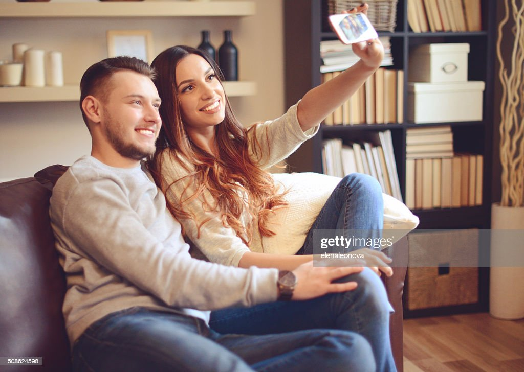 Young beautiful couple in home interior : Stock Photo