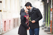Young beautiful couple kissing on the street