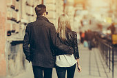 Photo of a young beautiful couple on busy city street