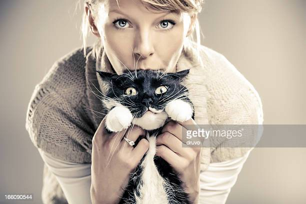 Young beautiful female with her cat