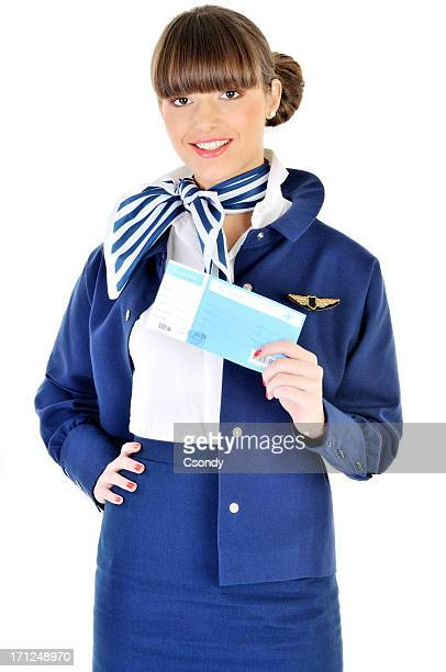 Young beautiful flight attendant holding ticket