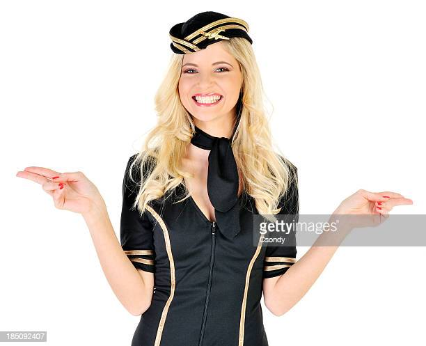 Young beautiful flight attendant showing the extits