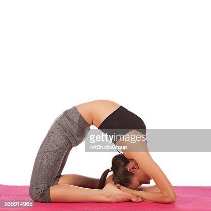 young beautiful girl yoga posing on a white studio background : Stock Photo