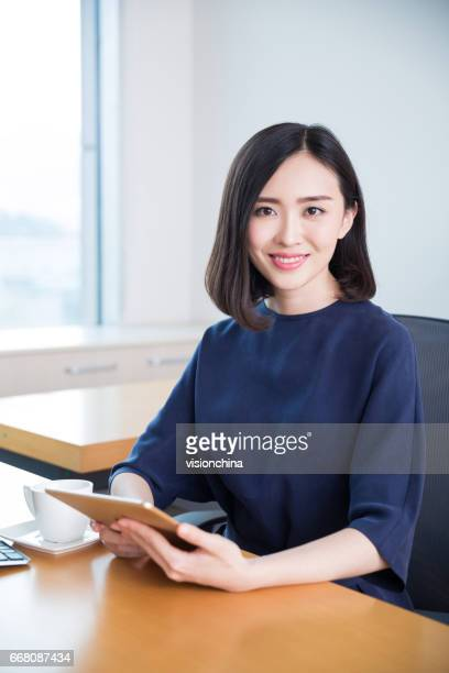 young beautiful girl,sitting in the office began her work