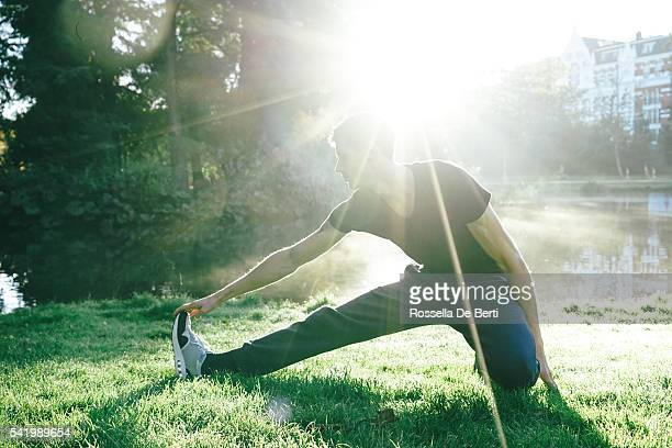 Young Beautiful Man Exercising Outdoors In The Early Morning