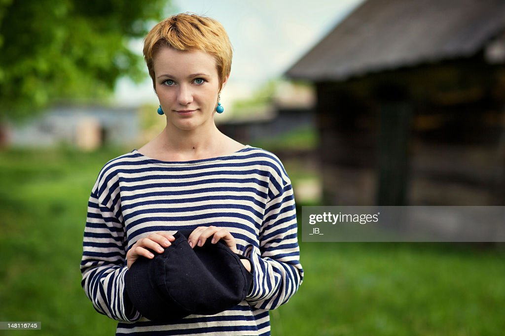 Young beautiful modest country girl poses : Stock Photo