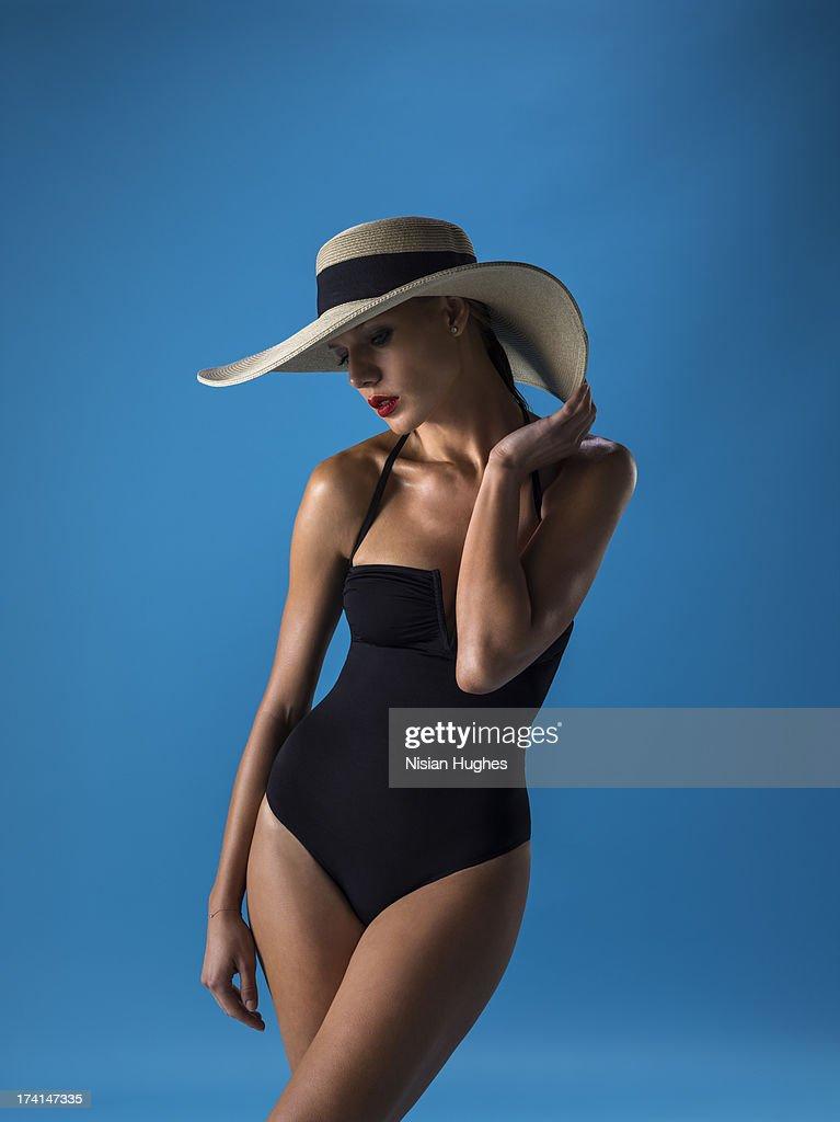 Young beautiful sexy woman in bikini and hat