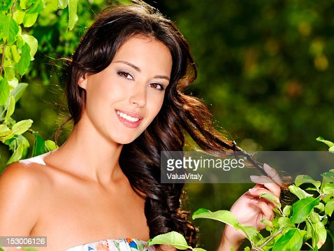 Young beautiful smiling woman outdoors : Stock Photo