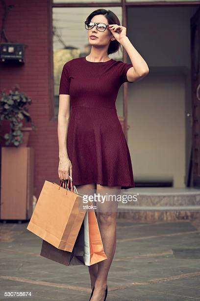 Young beautiful standing with shopping bags
