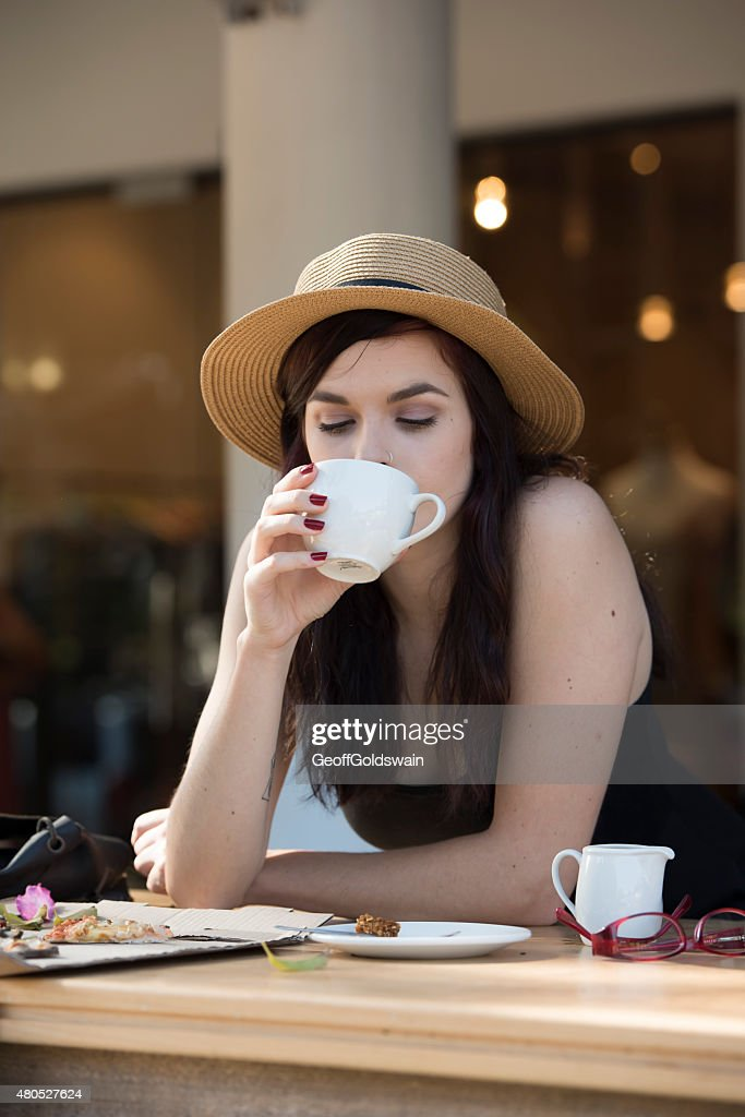 young beautiful traveler enjoying a coffee at street cafe : Stock Photo