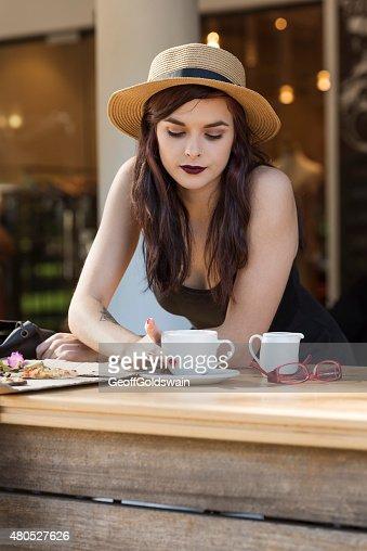young beautiful traveler enjoying a coffee at street cafe : Bildbanksbilder
