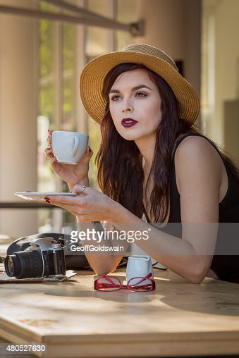 young beautiful traveler enjoying a coffee at street cafe : Stockfoto