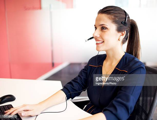 Young beautiful woman at her workplace in the office.