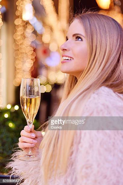 Young beautiful woman celebrating New Year's Eve