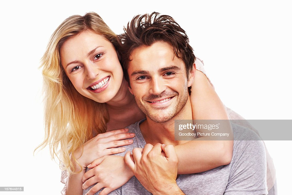 Young beautiful woman embracing a man isolated on white : Stock Photo