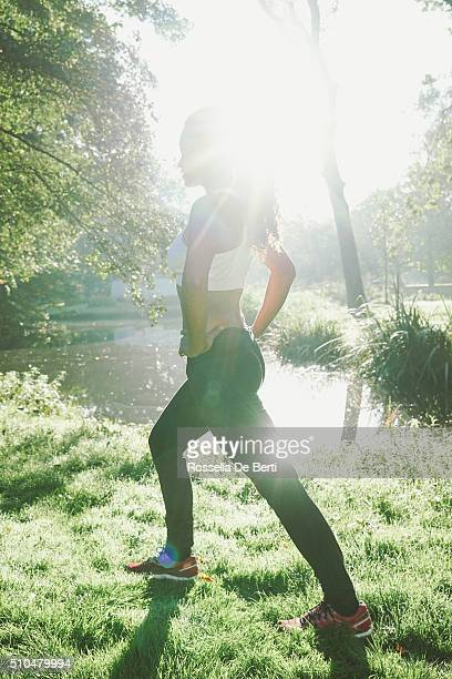 Young Beautiful Woman Exercising Outdoors In The Early Morning