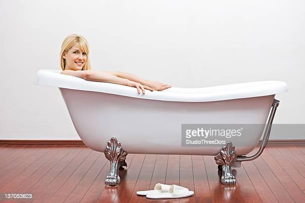 Young beautiful woman having bubble bath