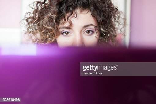 Young beautiful woman having fun with laptop In bedroom : Stock Photo