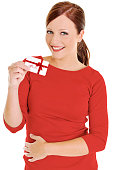 Young beautiful woman holding a gift card