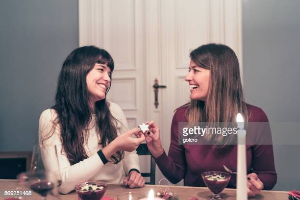 young beautiful woman holding christmas cookie at festive table