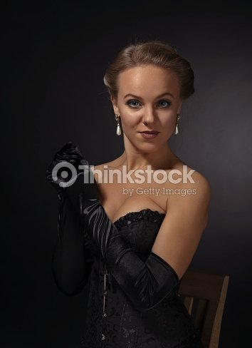 4d9dfe1ac01 young beautiful woman in black corset with pearl earrings   Stock Photo