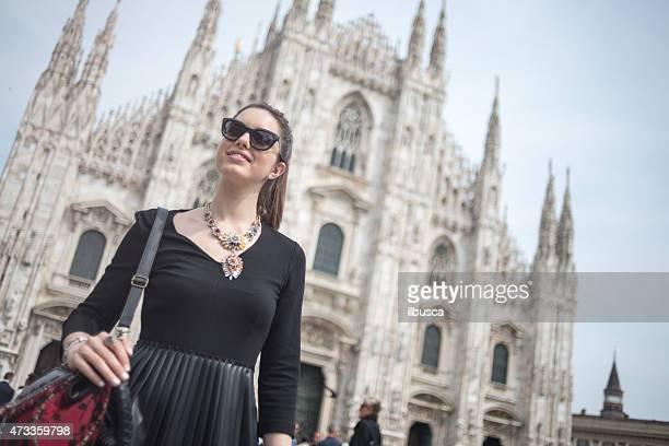 Young beautiful woman in front of Duomo, Milan
