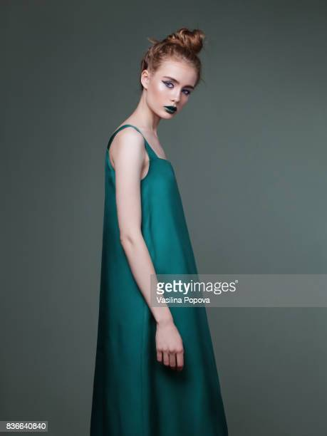 Young beautiful woman in green dress
